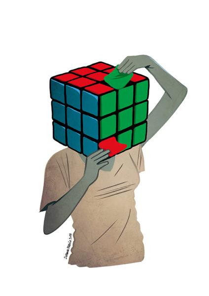 Una bollera recoloca las pegatinas del cubo Kubrik que lleva en la cabeza./ Susanna Martín