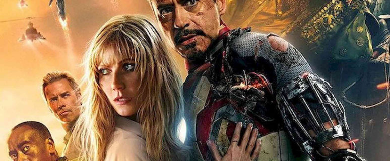 Cartel de 'Iron Man 3' en el que Gwyneth Paltrow aparece abrazada a Robert Downey Jr.